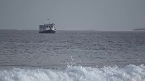 Boat, a big wave in the Indian Ocean. Maldives video. Horizontal stock footage