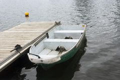 Boat on black lake on cloudy day Royalty Free Stock Photography