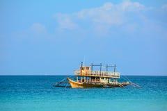Boat in the Blue Lagoon Boracay Island, Philippines Royalty Free Stock Photos