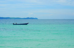 Boat in blue Sea. Fishing boat is in the middle of blue sea of Larn Island Stock Images