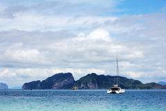 Boat with blue sea, blue sky and mountain. In Thailand Stock Images
