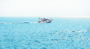 Boat in blue sea. Luxury turist boat ship at sea on summer vacation Stock Images