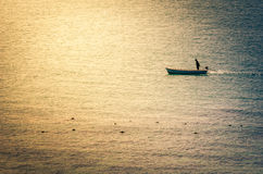 Boat on the blue sea vintage Stock Photography