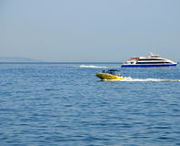 Boat on blue sea water. Stock Images