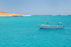 Boat on blue sea water in Egypt Stock Images