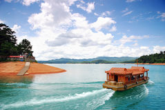 Boat and blue sky. Boat in the green river with blue sky Stock Photo