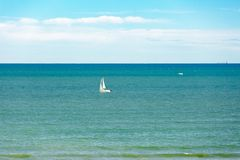 Boat in Mediterraneanblue sea water Royalty Free Stock Photos