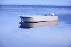 Boat in Blue Water Stock Images