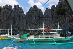Boat on blue water. Traditional filippino  in the sea. Palawan Philippines Stock Photo