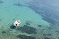 Boat on blue waters on the island of Samos, Greece Royalty Free Stock Photo