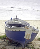 Boat blue and white. Old boat near the beach stock image