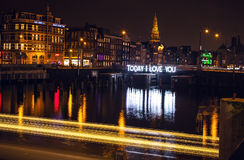 Boat with blur light moving on night canals of Amsterdam. Royalty Free Stock Image