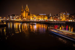 Boat with blur light moving on night canals of Amsterdam. Royalty Free Stock Images