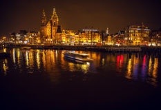 Boat with blur light moving on night canals of Amsterdam. Stock Photo