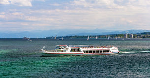 Boat on Bodensee lake between - Germany Royalty Free Stock Images