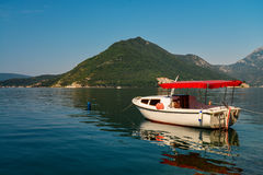 Boat in Boka Kotor bay. Near Perast and St.George Island, Montenegro Royalty Free Stock Images
