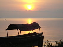 Boat at the border of the lake. It show the boats near the lake borde of lake victoria during the sunset and the boat has a loaf which protect people during the Stock Photo