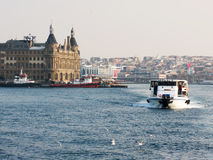 A boat in Bosporus on the background of Haydarpasa train station Stock Images