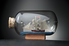boat in the bottle on black Stock Photo