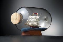 Boat in the bottle on black Stock Image