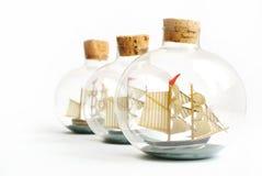 Boat in a bottle. Three Boat in glass bottles Royalty Free Illustration