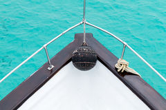 Boat Bow. Bow of a boat from overhead jutting out over the water stock photo
