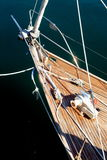 A boat bow. The bow of a sailing boat tied to a quay with a rope Stock Image