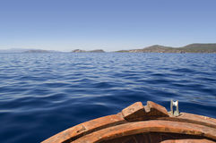 Boat bow. Old wooden fishing boat in the aegean sea Royalty Free Stock Photos