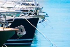 Boat bow with Anchor detail of sailboats in a row Stock Images