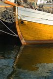 Boat bow and reflection. In calm waters Stock Photos