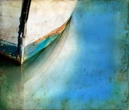 Boat Bow and Reflections on a Grunge background royalty free stock images