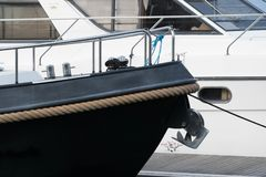 Boat bow with rope fender. A rope fender round a boat on a pontoon Royalty Free Stock Photos