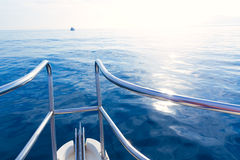 Boat bow sailing in blue calm sea Stock Photos