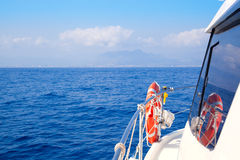 Boat bow sailing in blue Mediterranean sea Stock Photos