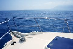 Boat bow sailing sea with anchor chain winch Royalty Free Stock Images