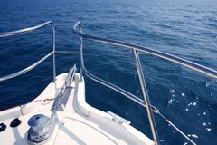 Boat bow sailing sea with anchor chain winch Stock Photos