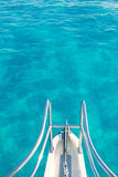 Boat bow in transparent turquoise  water Stock Images