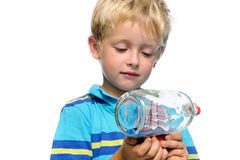 Boat boy. Young child holds an ornament; concept depicting ambition and future aspirations royalty free stock photos