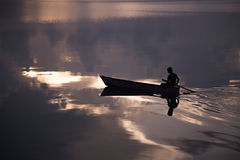 Boat and a boy. A boy sailing in the early morning in derawan kalimantan Stock Photography