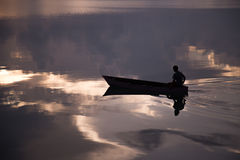 Boat and a boy. A boy sailing in the early morning in derawan kalimantan Stock Images