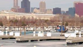 Boat breaking through ice in harbor along shoreline of Lake Michigan, Chicago stock video