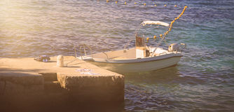 Boat and Breakwater Royalty Free Stock Image