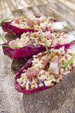 Boat of brown rice with red radicchio and speck Stock Image