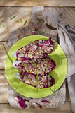 Boat of brown rice with red radicchio and speck Stock Photos