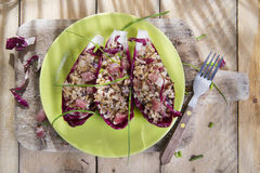 Boat of brown rice with red radicchio and speck Royalty Free Stock Photography