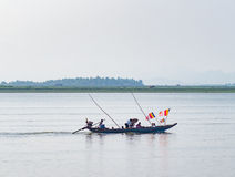 Boat with Buddhist flags in Myanmar Royalty Free Stock Photography