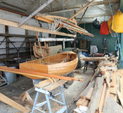 Boat Building Workshop. A boat builders workshop with a partly constructed boat Royalty Free Stock Photo