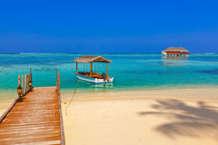 Boat and bungalow on Maldives island Stock Images