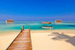 Boat and bungalow on Maldives island Royalty Free Stock Image