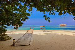 Boat and bungalow on Maldives island Royalty Free Stock Photography